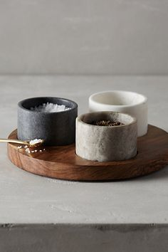 Useful spice pots in wooden dish