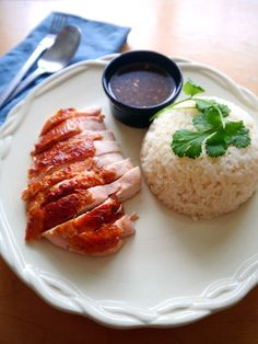 Try out Khao Man Gai, a quick weeknight meal that uses a rotisserie chicken to make Thai chicken and rice with a ginger chili dipping sauce! Thai Chicken Recipes, Asian Recipes, Asian Foods, Thai Recipes, Yummy Recipes, Yummy Food, Khao Man Gai Recipe, Love Food, A Food