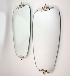 Pair 1950s Mid Century Italian Brass Wall Mirrors | From a unique collection of antique and modern wall mirrors at https://www.1stdibs.com/furniture/mirrors/wall-mirrors/