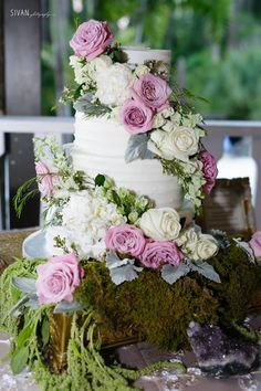 An Enchanted Forest Inspired Wedding   Textured Buttercream Wedding Cake by Party Flavors Custom Cakes with Cascading Fresh Flowers