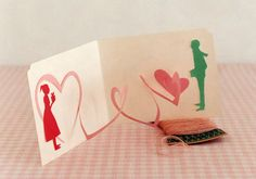 Make a pop-up card that shows your hearts are connected.