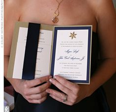 Formal Navy Invitations  The script font used for the couple's names was printed in a dark blue that matched the solid border. A wide navy ribbon held the inserts in place