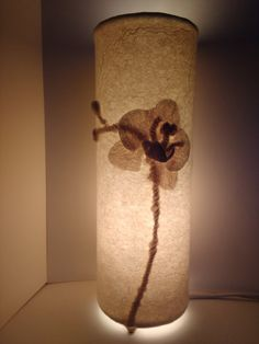 This listing is for the complete lamp. With the addition of small bead feet, it makes this lampshade into a complete lamp. This lamp depicts an orchid flower with 2 buds waiting to open. The lamp emits a warm cosy light giving any room a cosy feel. The wool felt is lined with the