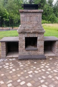 Unlike an open fire pit, this structure has a chimney to carry smoke up and away from guests. Two built-in wood boxes provide an ample supply of dry wood. Request a free quote for your patio project at http://ajbservice.com/contact-us.