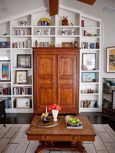 Striking wall of shelves built to follow vaulted ceiling and around armoire.  From Houzz Built In Bookshelves Design, Pictures, Remodel, Decor and Ideas - page 6