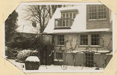 Exterior view of a snow covered Monk's House (Rodmell, England), 1938