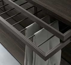 """""""Dress Bold"""" Wardrobe with extractable trousers rack and container. (by Rimadesio)"""