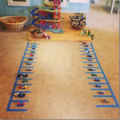 Letter hunting with matchbox cars!  This is a fun way to combine learning letters and playing at the same time!  playful learning, preschool literacy, abcs, learning through play, crozet playschool