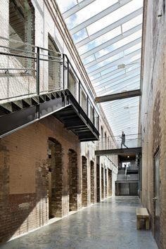 Image 10 of 17 from gallery of MASS MoCA Building 6 / Bruner/Cott & Associates. Photograph by Michael Moran Auxerre, Property Buyers, Urban Loft, Adaptive Reuse, Urban Industrial, Built In Storage, Diy Garden Decor, Atrium, Home Improvement Projects