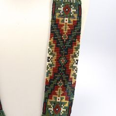 """11 Strand Beaded Necklace with Navajo Rug Designs using Glass Beads and with Matching French Hook Earrings and a Sterling Silver Clasp. 32"""" Necklace Length"""