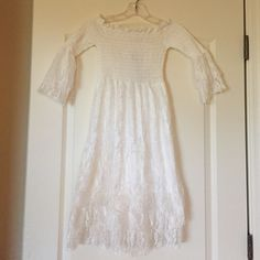 Bohemian style white lace dress Bohemian style white longsleeved dress skirt has lace overlay and lace sleeves. NWT never worn. Size X small Dresses Long Sleeve