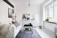 Small monochrome living room with HAY coffee tables