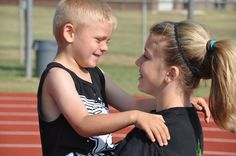 Friendly chat     Jayslin King, 13, visits with a young friend, Braylon Harvey, 5, after the Thursday session of Brownwood High School's track camp at the high school track. Jayslin's and Braylon's families attend First Baptist Church in Early.  #bwdbulletin #bwdsummer