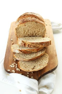 Easy, 9-ingredient seeded whole grain bread with oats, sunflower seeds, and flaxseed. Hearty, wholesome and so simple to make!
