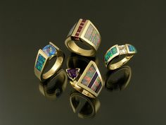 Australian opal rings by The Hileman Collection. Opal inlay rings accented by colorful gemstones such as rubies, amethyst and topaz set in yellow gold. Dinosaur Bone Ring, Dinosaur Bones, Australian Opal Jewelry, Opal Wedding Rings, Turquoise Jewelry, Ring Designs, Bracelets, Unique Jewelry, Rings For Men