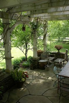 Pergola with weathered wood and wire furniture