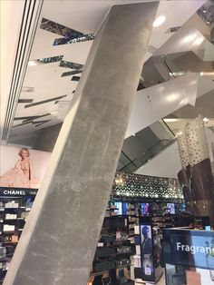 Photo 3: Here unclad, preformed concrete has been used for the pillars in Myer. 5 levels-a feature was made of the pillars, central void, light-well ceiling & open construction when renov. approx 2010. Concrete accentuates open construction-grey is seen in most finishes. Other surfaces-clad, shiny & polished so the exposed concrete offers contrast.