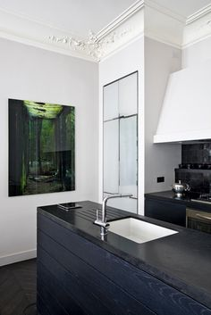 Gorgeous art everywhere but particularly in modern kitchen. Love every part of this apartment.