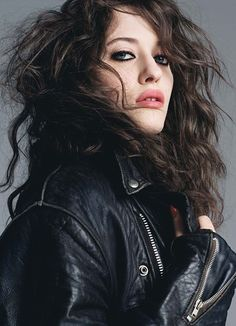 Kat Dennings and big hair and leather and zippers..