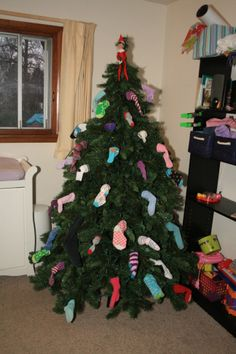 decorating the Christmas tree with clean socks from the laundry basket