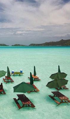 Picnic tables in the ocean. St. Regis Hotel, Bora Bora.