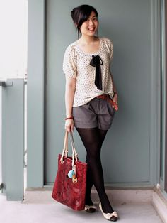 I love the look of shorts with tights but I've never attempted to pull it off... Monochroma.chic