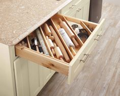 Keep your baking needs within reach by reorganizing your kitchen's shallow drawers with diagonal spacers to store rolling pins, measurement tools, small gadgets, and spatulas. Not only will the contents stay in place when the drawer is in motion, but it also gives you a clear view for quick finds. See more of Martha's creative drawer organization solutions with this video.