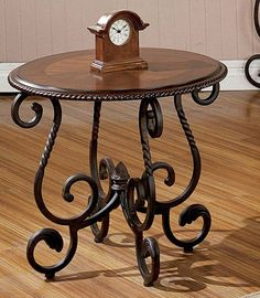 Add Old World flair to your living space, Antiqued Round End Table. Scalloped edging inlaid design iron metal base.