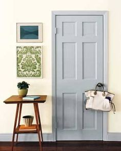 door and trim are same grey color...walls white with colored wall hangings?