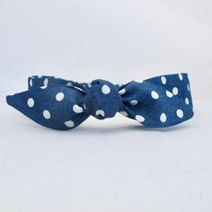 Blue Polka Dot Baby Headband. Our baby headbands are an alternative to the traditional colours and patterns usually offered for babies.  Each headband is made from lightweight cotton to keep your baby's head cool in the warmer months. We have carefully chosen elastic with a gentle stretch so each headband stays securely on, yet is not too tight.
