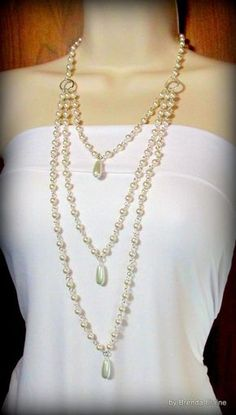 Necklace - Long, Elegant Strands of Pearls with Teardrops.