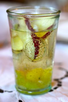 I first made this white sangria years ago, for an L. friend's birthday party, and on New Year's Eve I decided to revisit the recipe, this time using sparkling wine rather than regular old pinot grigio. Happy Hour Drinks, Fun Drinks, Yummy Drinks, Alcoholic Drinks, Beverages, Winter Sangria, Winter Cocktails, Christmas Drinks, Holiday Drinks