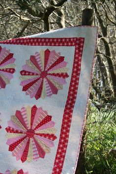 red, white, pink, yellow...from blog: Rosealie Quinlan designs (free pattern available on Lecien late 2012)
