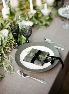 Thanksgiving Place Settings: Herbs and a Bow #place-settings, #napkins, #glassware, #plates Photography: Clayton Austin - loveisabird.com View entire slideshow: Thanksgiving Place Settings on http://www.stylemepretty.com/collection/798/