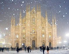 Duomo Cathedral in the snowfall, Milan, Italy **    Milan Cathedral (Italian: Duomo di Milano; Lombard: Domm de Milan) is the cathedral church of Milan, Italy. Dedicated to Santa Maria Nascente (Saint Mary Nascent), it is the seat of the Archbishop of Milan, currently Cardinal Angelo Scola.  The Gothic cathedral took nearly six centuries to complete. It is the fifth largest cathedral in the world and the largest in the Italian state territory.