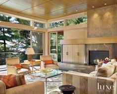 Neutral Contemporary Living Room with Limestone Fireplace