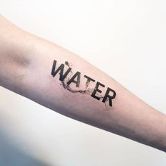 Water tattoo on the left inner forearm.