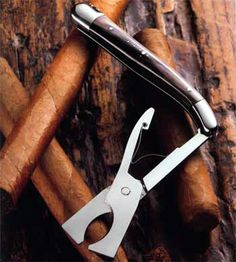 Did you know Forge de Laguiole has also created a perfect tool for cigar lovers? A unique and prestigious accessory, which cannot be compared with others cigar cutters! This model, delivered with its leather sheath and gift box, is available in: - Black Horn Tip with mirror finish stainless steel - Thuya Burl with mirror finish stainless steel - Briar Wood with satin finish stainless steel.