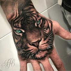 Tattoos are one of the most famous ways for someone to express themselves or show their beliefs. The tiger is the largest extant cat species. Below, we are going to mention tiger tattoos on hand. Tiger Hand Tattoo, Tiger Tattoo Design, Rose Hand Tattoo, Tattoo Designs, Hand Tattoos For Guys, Baby Tattoos, Unique Tattoos, Small Tattoos, Tigeraugen Tattoo