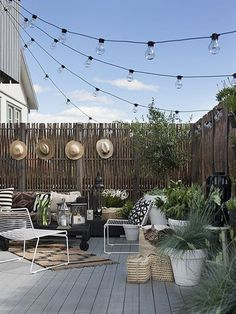 Neutral And Natural Tones And Festoon Lighting - Ideas About How To Add Character And Privacy To A Blank Canvas Outdoor Space Such As A New Build Garden.