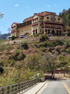 "The Grand Hotel in Jerome Arizona sits at the top of the town overlooking everything.  It was originally a hospital, one of the most ""modern"" of its time, and then sat dormant for 40 years.  The boilers started right up and the switchboard is still operational!  It's an awesome place to visit!"