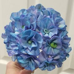 Happy weekend everyone! This is a Sola wood Hydrangea that I quickly painted for a spring centerpiece. I'll make a video next time so you can see how easy it is! We're still working hard to get all of the flower varieties for sale online, but there are a bunch in the store already.  Check them out now!