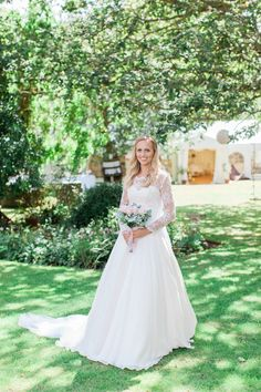 Naomi Neoh Fleur blush wedding dress with long lace sleeves -  Image by Camilla Arnhold - Naomi Neoh Fleur blush wedding dress for a beautiful peach and online dating themed back garden wedding with unique gift ideas for bridesmaids