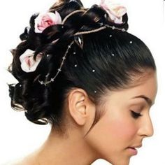 Curly up-do accessorized with flowers and beaded string