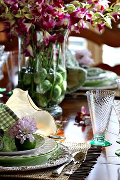 I particularly like the brussel sprouts in the vase as well as the lime flower holder at each place setting!!  :)