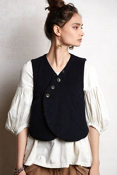 Like the idea of wearing waistcoat over plain top. The pleats on the sleeves gives it a bit of oomph