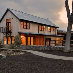 weathered wood barn to the road, and has metal-clad sheds behind. The design process was driven by the metaphor of an old farmhouse that had been incrementally added to over the years. The spaces open to expansive views of vineyards and unspoiled hills. Erick Mikiten, AIA