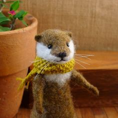 Needle felted Otter with hand knit scarf by LittleWoolTails