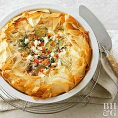 Go Greek and serve this spinach and zucchini pastry as a light lunch or a delicious dinner side. Flaky phyllo dough makes the savory pie crust crunchier than traditional pastry.