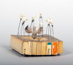 TacxBook fragments, wire, PVA glue, nails, polymer clay, feathers, thread, sand, 3.75 x 4 x 4 inches, 2007